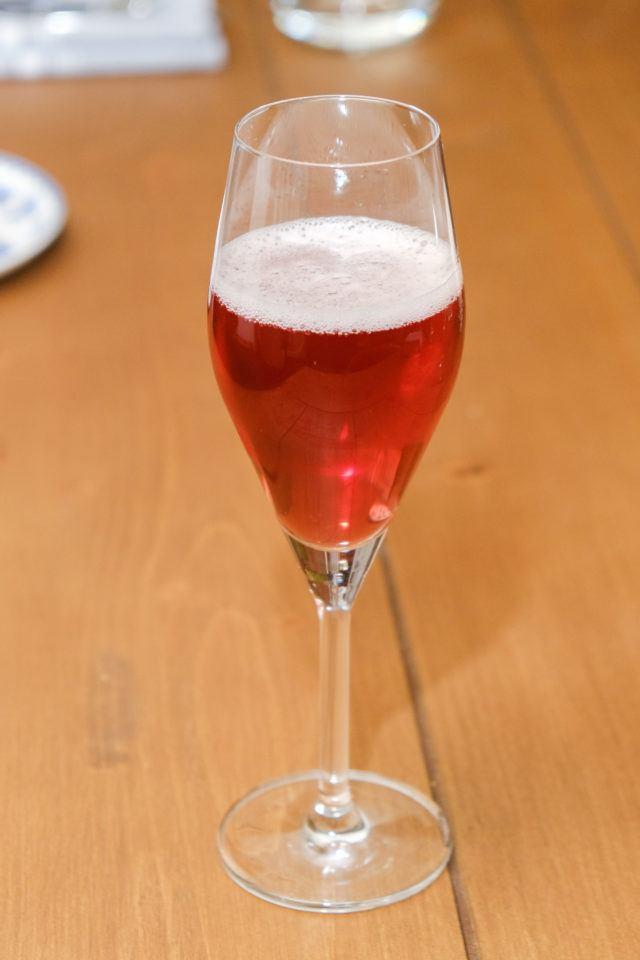 Orange cocktail in a champagne flute