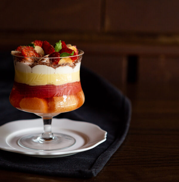 Dorset Lardy Cake served in a clear glass dessert goblet sitting on a white decorative plate